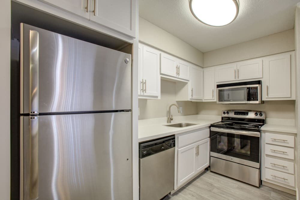 Modern finishes and stainless steel appliances in the kitchen at Aventerra at Dobson Ranch in Mesa