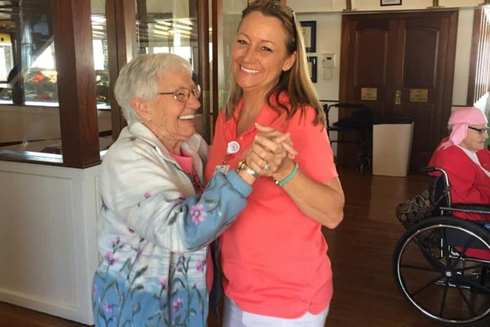 A resident and caretaker dancing at Harrison Springs Health Campus in Corydon, Indiana