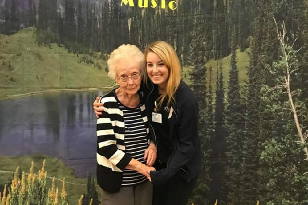 A resident and caretaker posing for a photo at Harrison Springs Health Campus in Corydon, Indiana