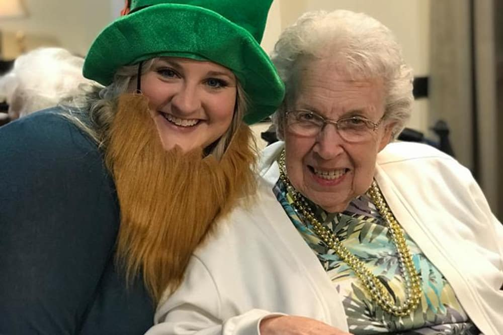 A caretaker and resident dressed for St. Patrick's day at River Terrace Health Campus in Madison, Indiana