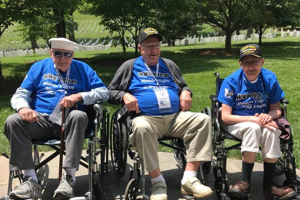 Three veterans from River Terrace Health Campus in Madison, Indiana at a veterans memorial