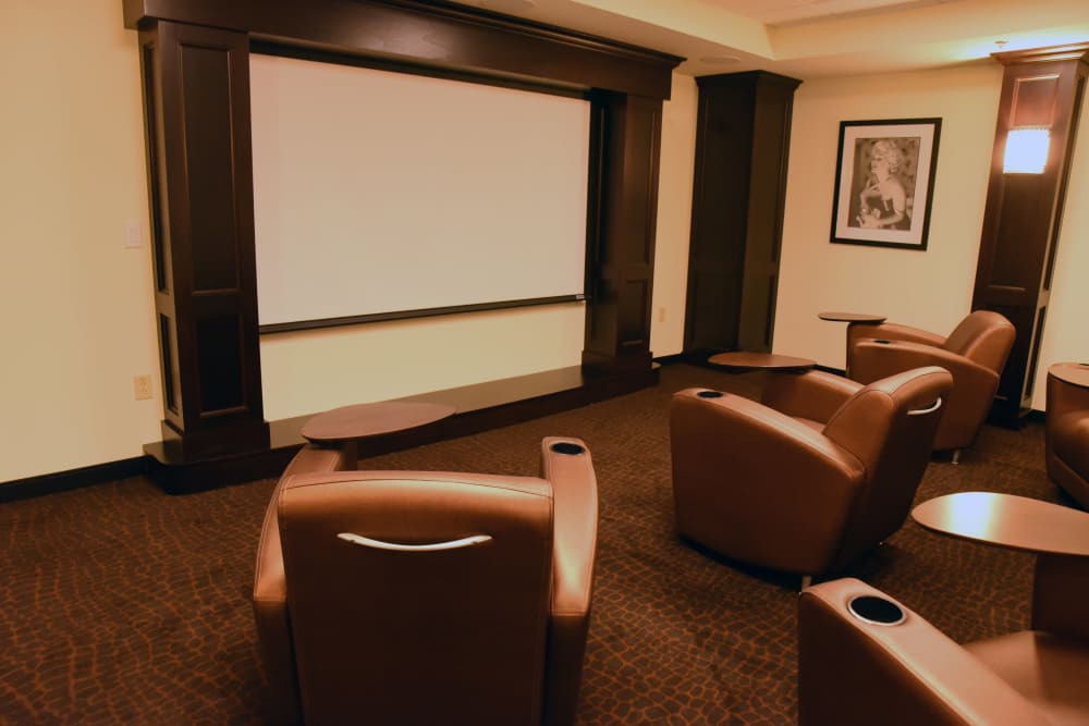 Community theater with trays attached to the seats at River Terrace Health Campus in Madison, Indiana
