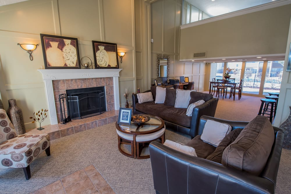 Fireside seating at Fox Run Apartments' clubhouse in Wichita, Kansas