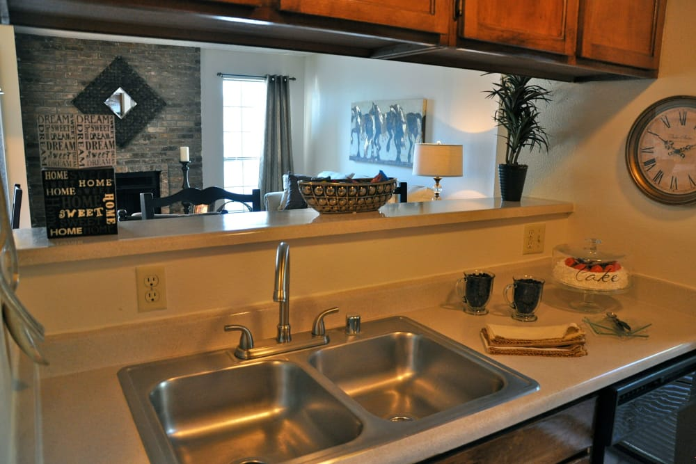 Kitchen with a view of the living room at High Ridge Apartments in El Paso, Texas