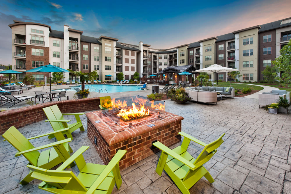 Fire pit with seating near the pool at Perimeter Lofts in Charlotte, North Carolina