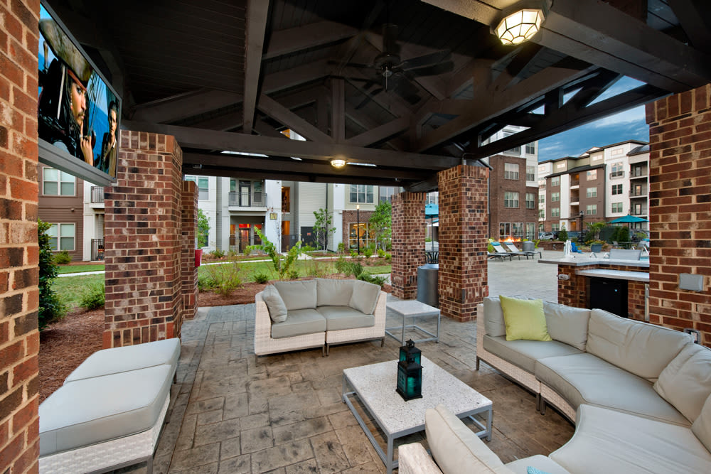 Covered cabana with comfortable seating at Perimeter Lofts in Charlotte, North Carolina