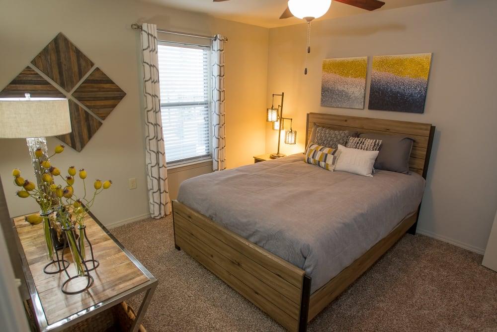 Primary bedroom with plush carpeting at Icon at Corpus Christi in Corpus Christi, Texas