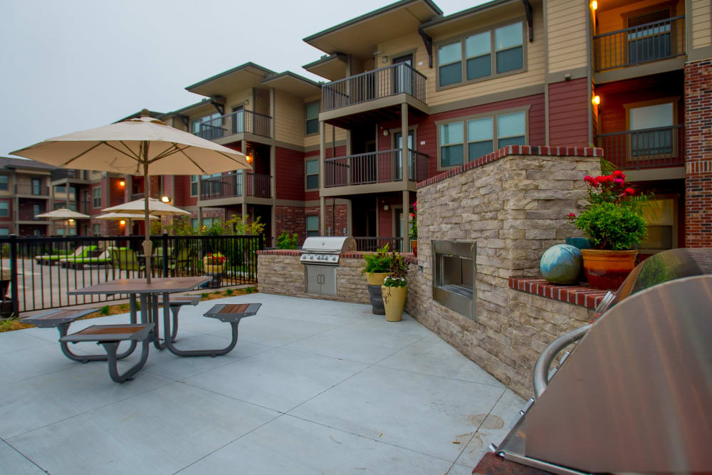 Outdoor patio with a grill at Icon at Corpus Christi in Corpus Christi, Texas