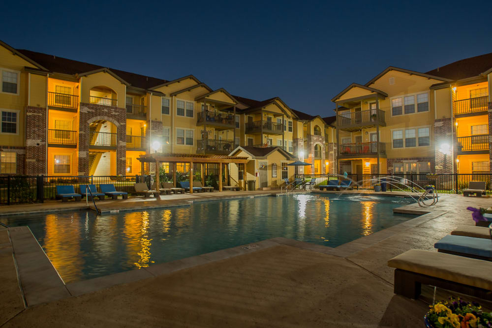 Mission Point Apartments' buildings and pool at night in Moore, Oklahoma