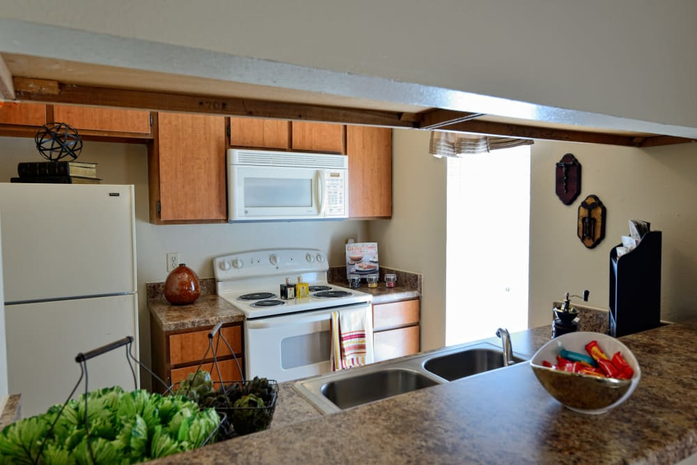 Kitchen with plenty of cabinet space at Mountain Village in El Paso, Texas
