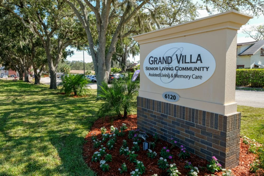 Memorial sign at Grand Villa of New Port Richey in Florida