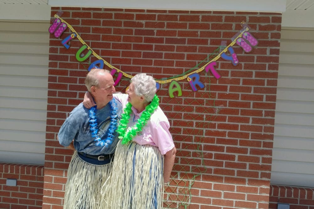 A happy couple during a hula party at Bethany Pointe Health Campus in Anderson, Indiana