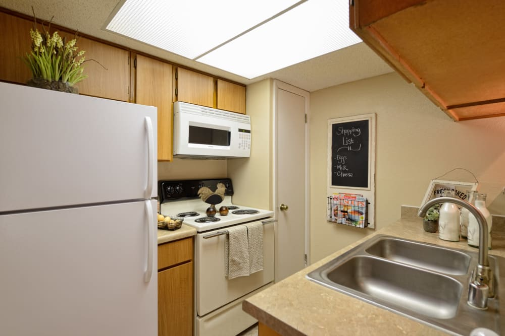 Kitchen with white appliances at Shadow Ridge Apartments in El Paso, Texas