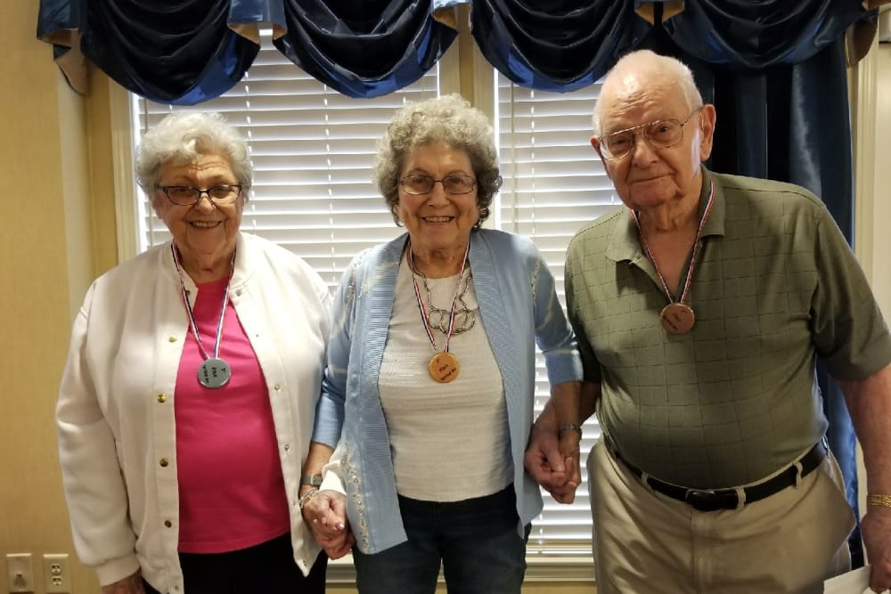Three residents holding hands at Blair Ridge Health Campus in Peru, Indiana