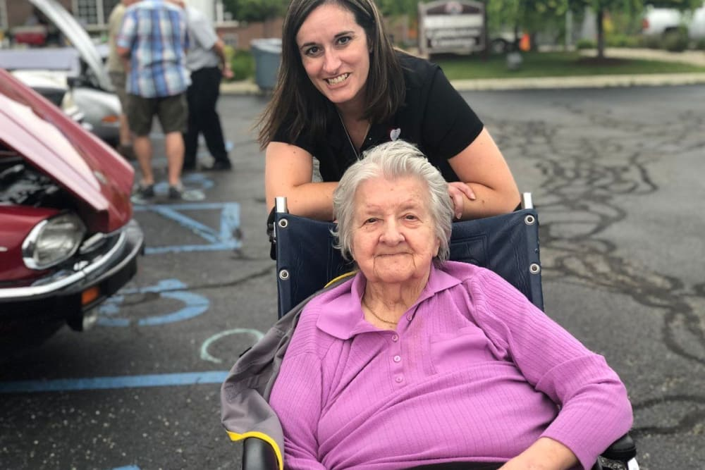 A caretaker and resident posing for a photo at Cobblestone Crossings Health Campus in Terre Haute, Indiana