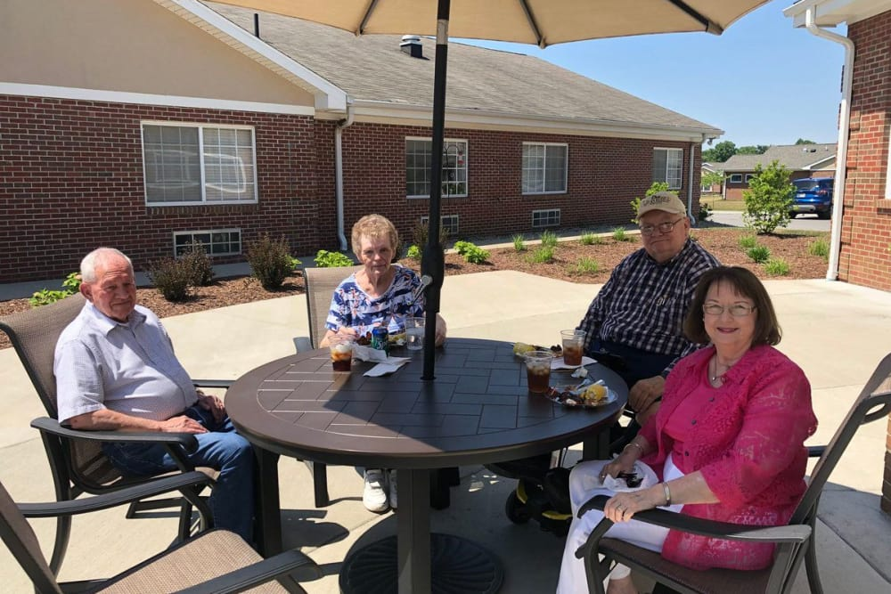 Residents enjoying the weather outside at Cobblestone Crossings Health Campus in Terre Haute, Indiana