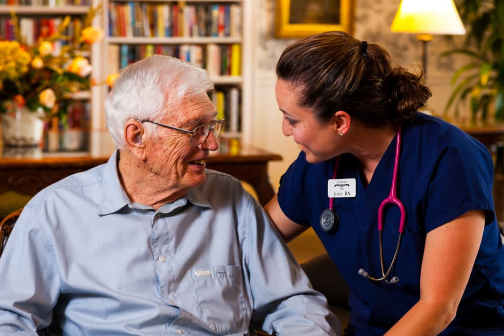 senior resident with staff member