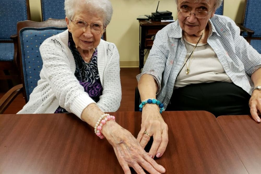 Two residents showing off their bracelets at Creasy Springs Health Campus in Lafayette, Indiana