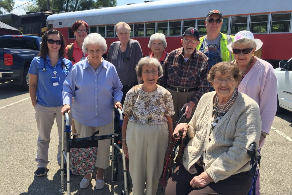 A group of residents posing for a photo outside the community bus at Forest Glen Health Campus in Springfield, Ohio