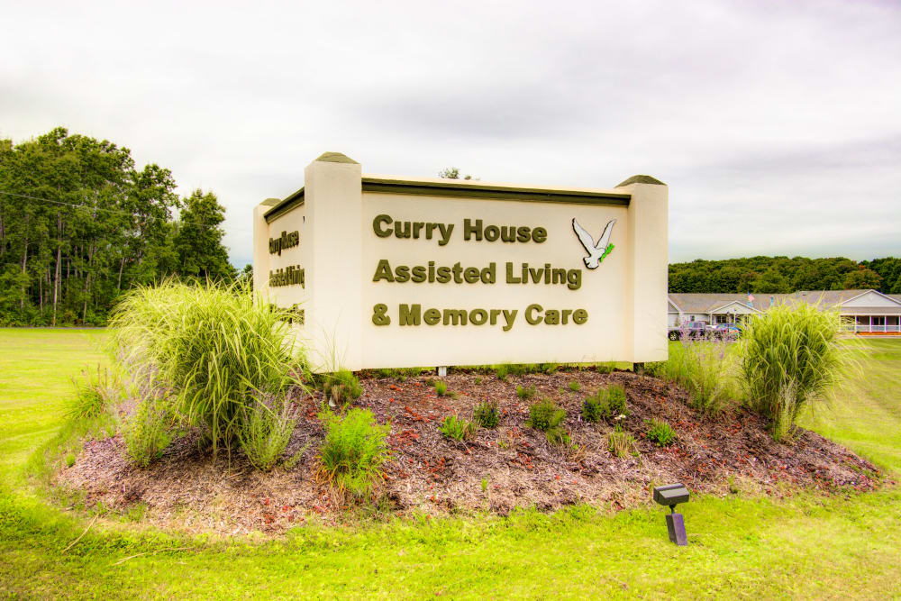 Welcome sign at Curry House in Cadillac, Michigan