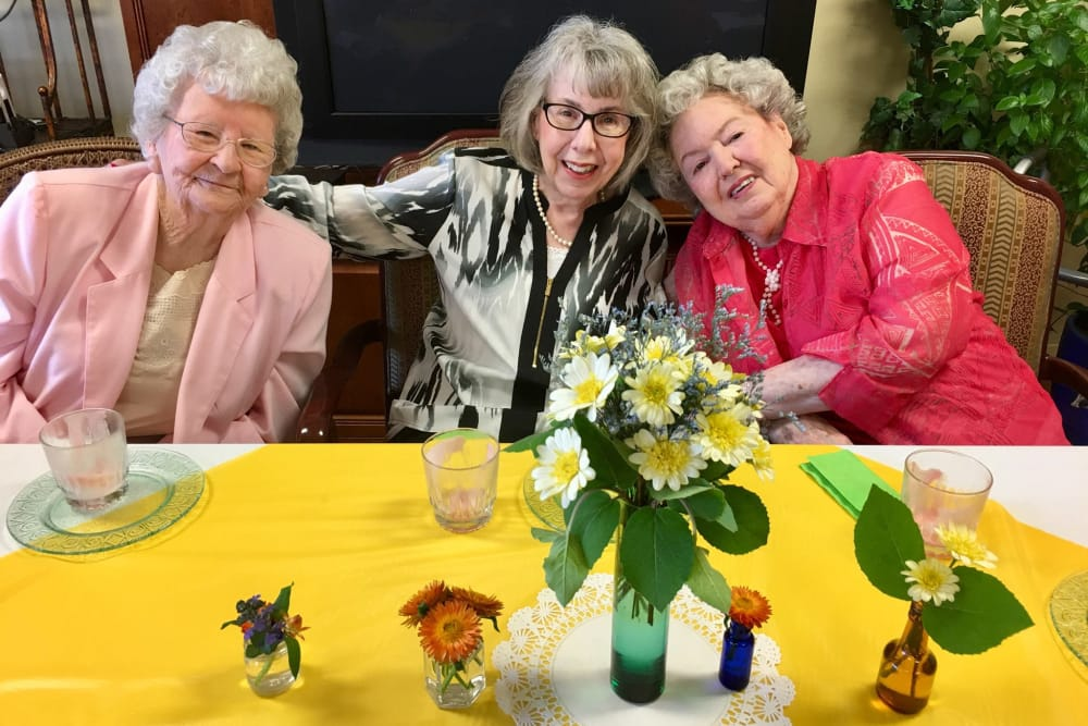 Three residents sitting at a dining table at Morrison Woods Health Campus in Muncie, Indiana