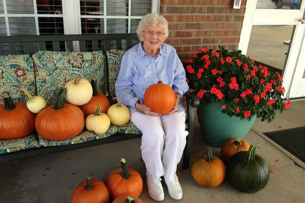 A resident sitting on the porch with pumpkins at Morrison Woods Health Campus in Muncie, Indiana