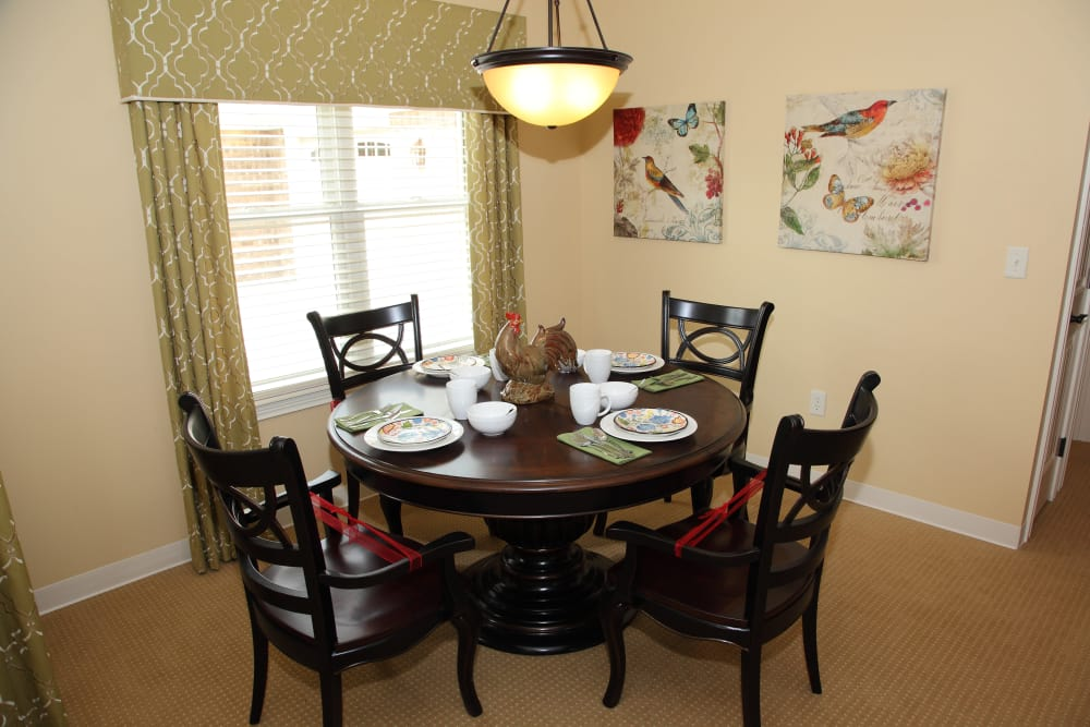 Carpeted dining room in a villa at Oakwood Health Campus in Tell City, Indiana