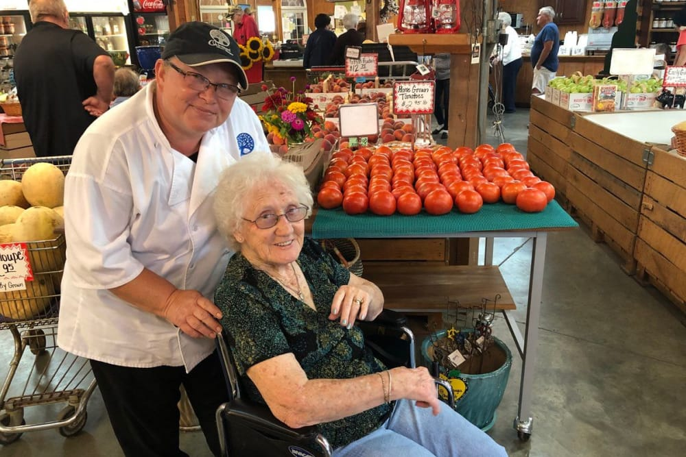A caretaker from Oakwood Health Campus in Tell City, Indiana assisting a resident grocery shopping