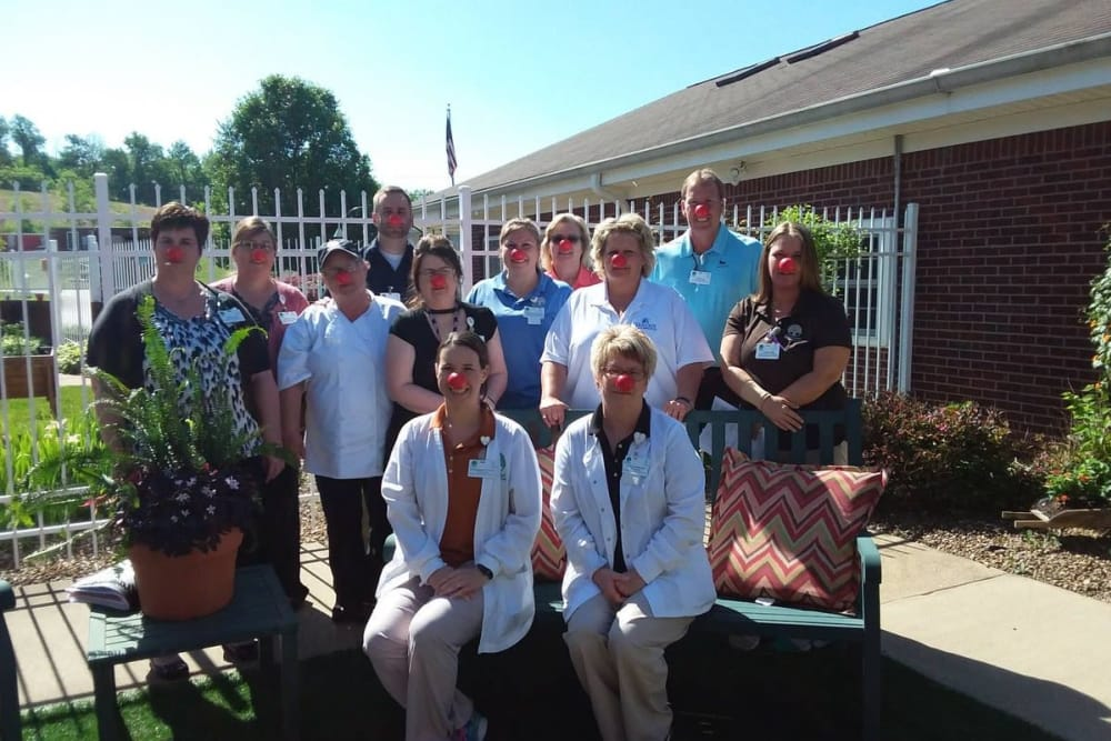 A group of caretakers with red noses on at Oakwood Health Campus in Tell City, Indiana