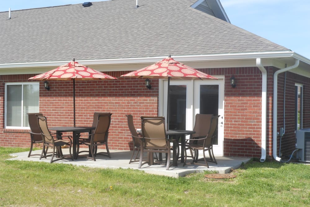 Covered seating on the patio outside of the clubhouse at Oakwood Health Campus in Tell City, Indiana