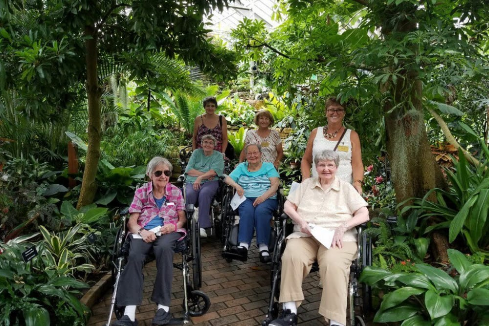 Residents from Springhurst Health Campus in Greenfield, Indiana in a greenhouse