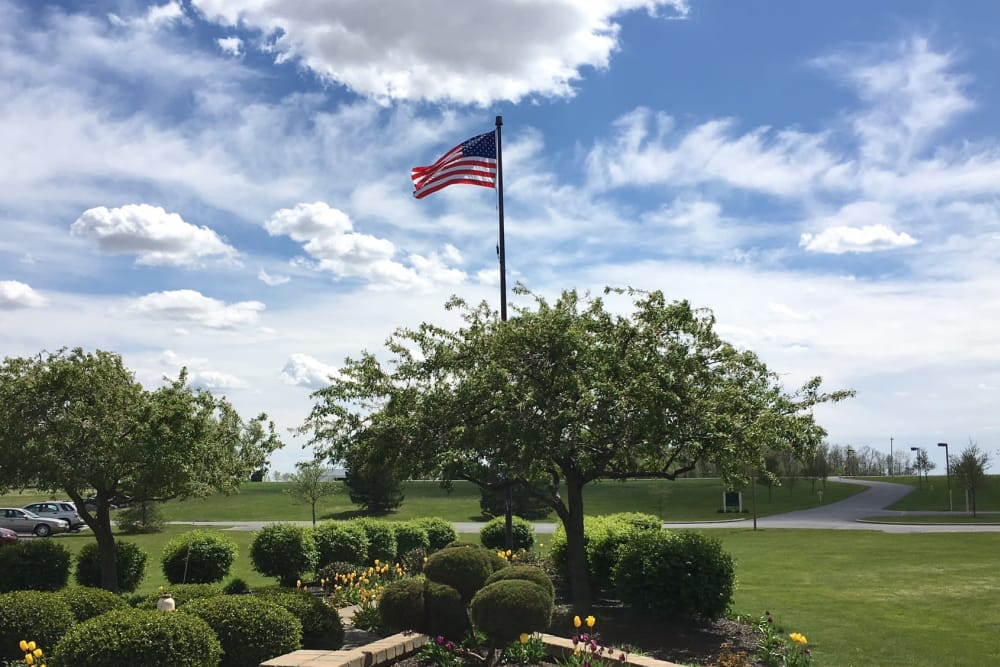Beautiful landscaping surrounding the flagpole at The Meadows of Leipsic in Leipsic, Ohio