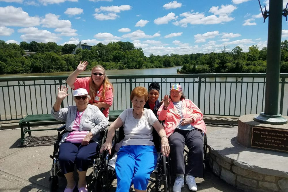 Residents and caretakers from Triple Creek Retirement Community in Cincinnati, Ohio posing in front of a waterfront