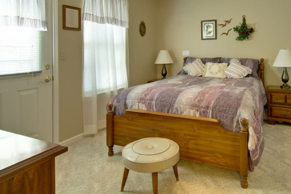 Assisted living bedroom at NorthPark Village Senior Living in Ozark, Missouri
