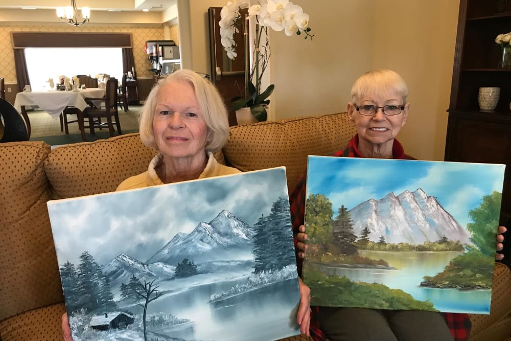 Two residents holding their paintings at Waterford Place Health Campus in Kokomo, Indiana