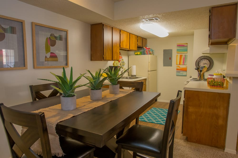 A well decorated dining room table at Cimarron Trails Apartments in Norman, Oklahoma