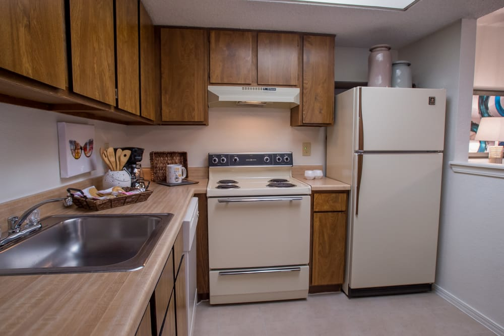 Fully equipped kitchen at Copperfield Apartments in Oklahoma City, Oklahoma
