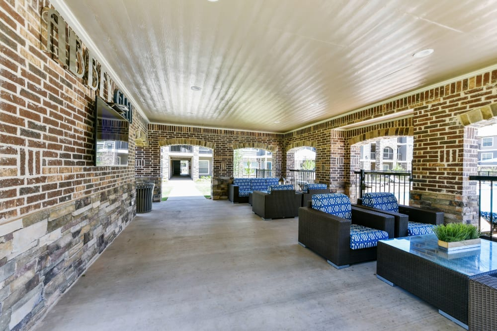 Outdoor lounge area at Cottages at Abbey Glen Apartments in Lubbock, Texas
