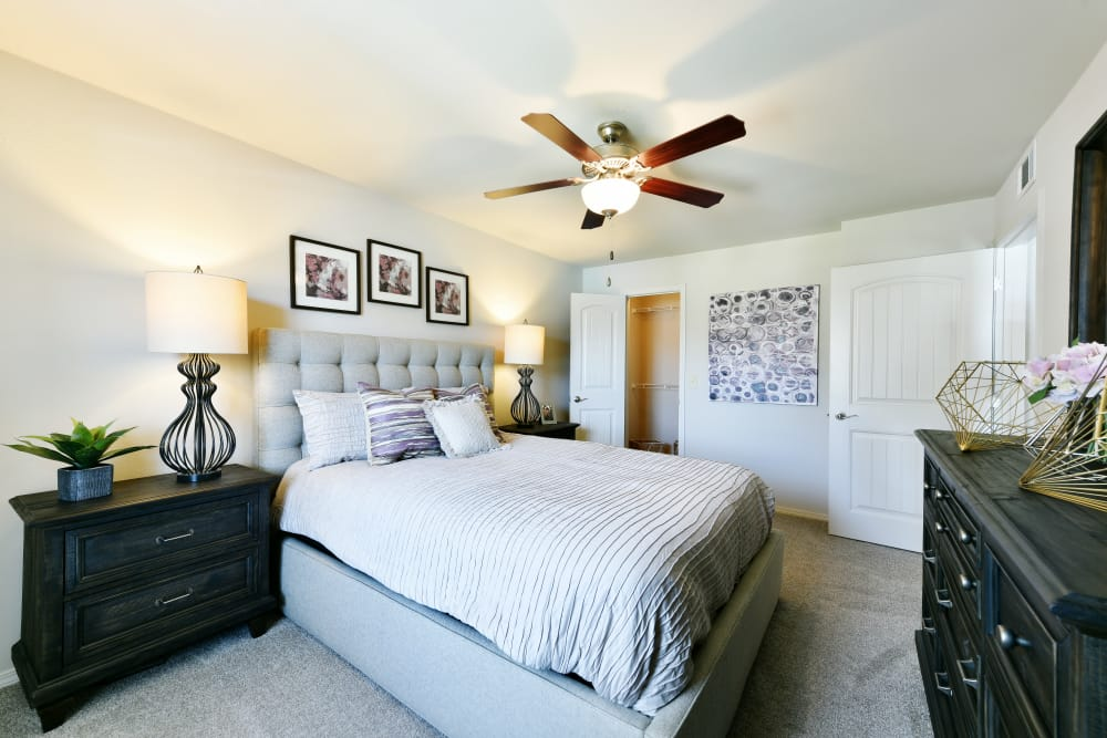 A well decorated bedroom at Cottages at Abbey Glen Apartments in Lubbock, Texas