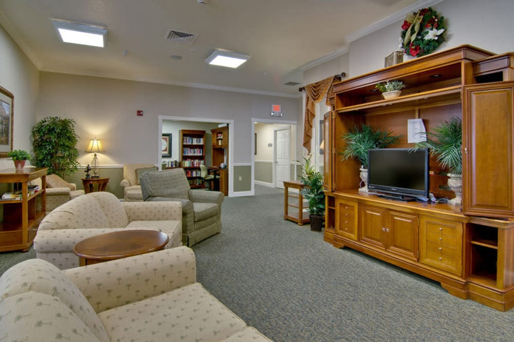 Cozy entertainment room at Foxberry Terrace Senior Living in Webb City, Missouri