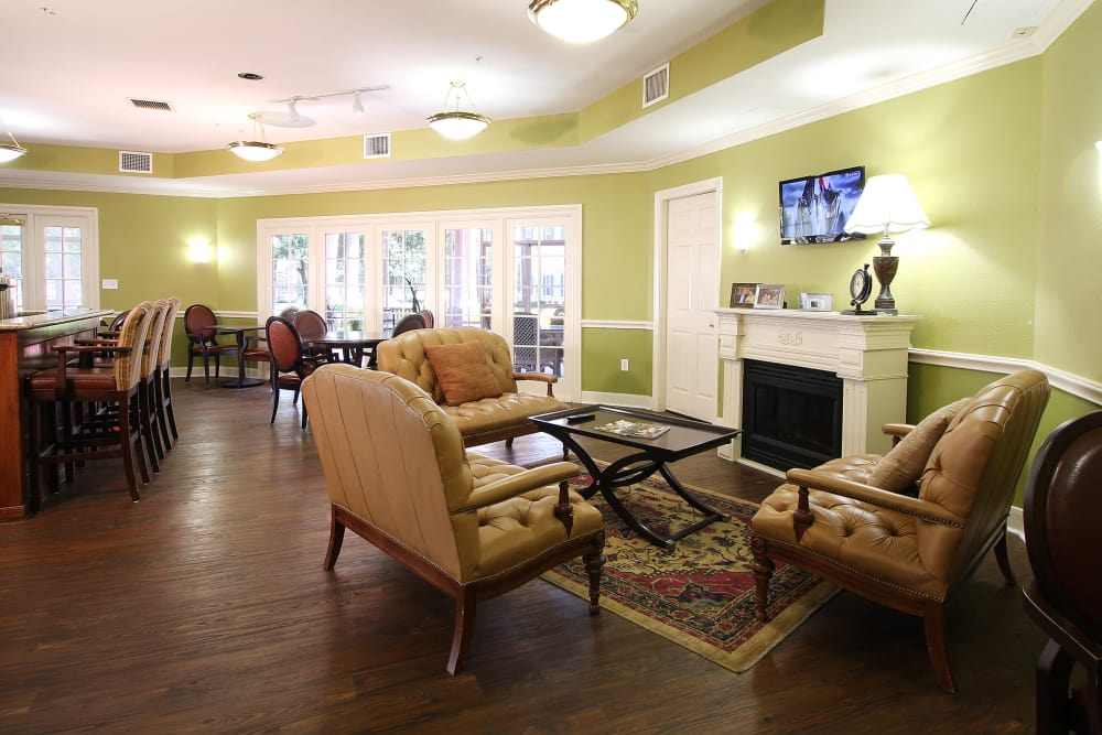 Living room with fire place at Reunion Court of Kingwood in Kingwood, Texas
