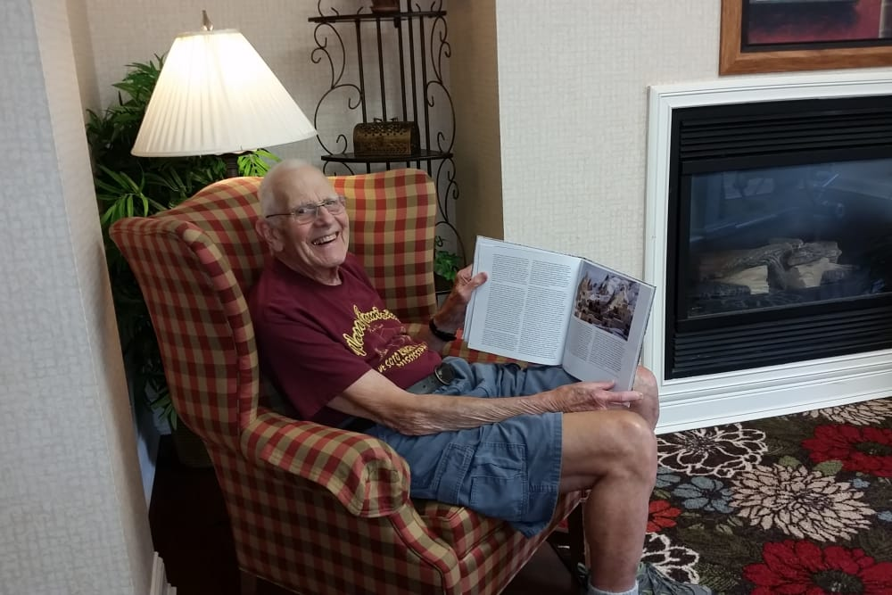 A resident showing the camera the book he is reading at Senior Living at Forest Ridge in New Castle, Indiana