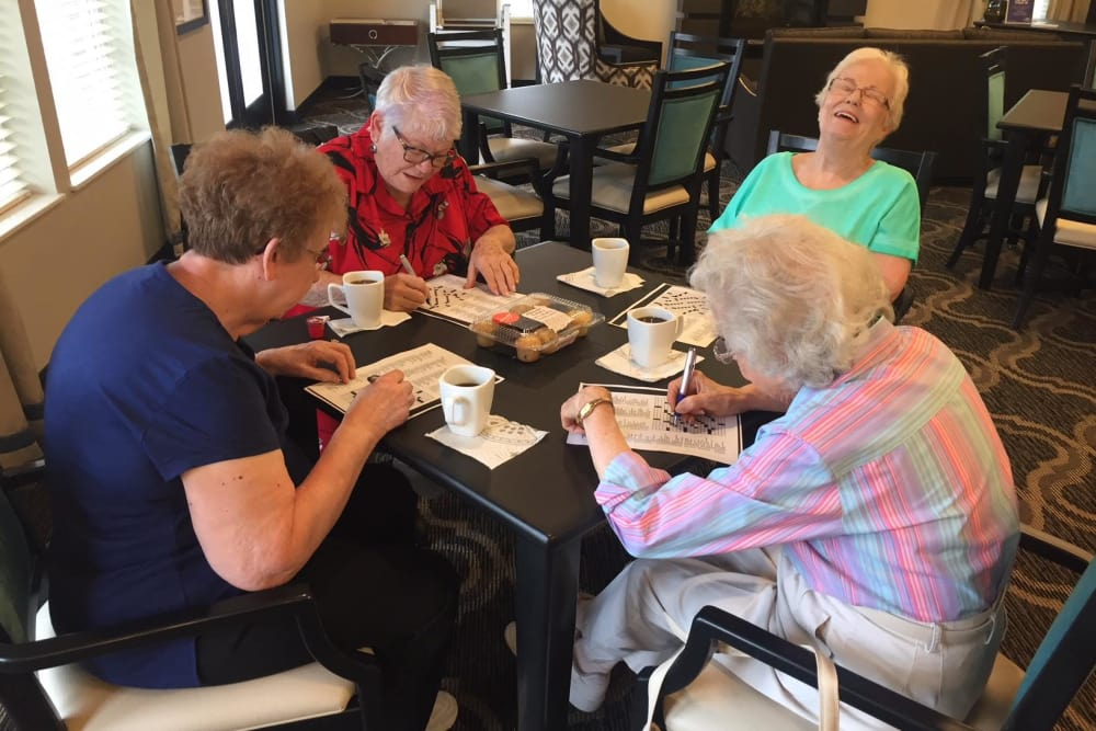 Residents filling out crossword puzzles together at North River Health Campus in Evansville, Indiana