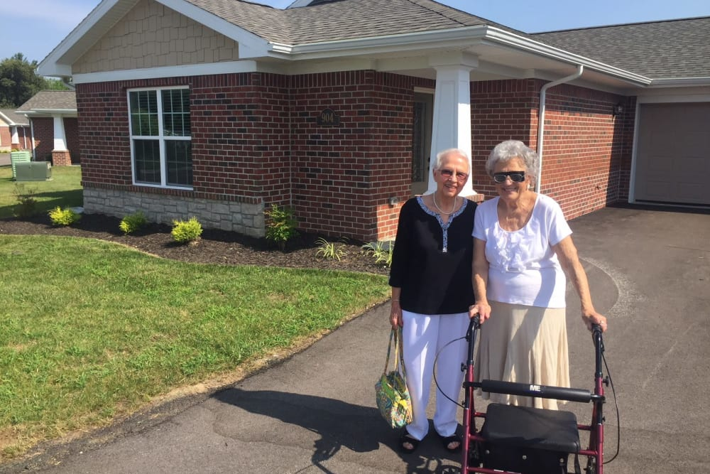 Two residents posing for a photo outside a villa at North River Health Campus in Evansville, Indiana