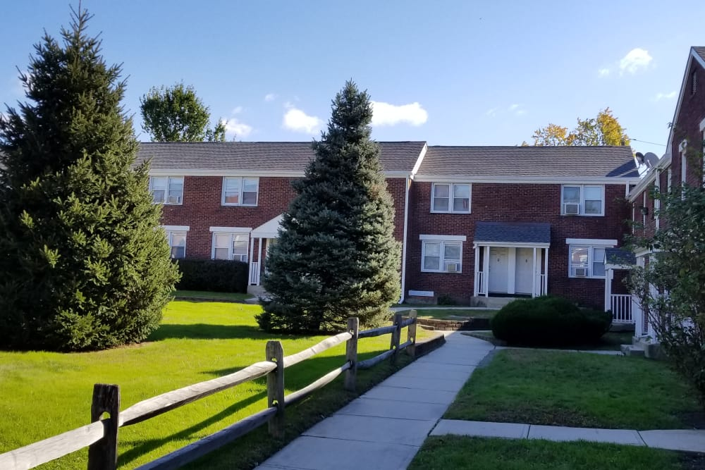 Green areas and apartment buildings at Warner Village Apartments in Trenton, New Jersey