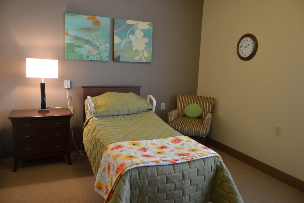 Decorated apartment bed at Arlington Place Health Campus in Indianapolis, Indiana