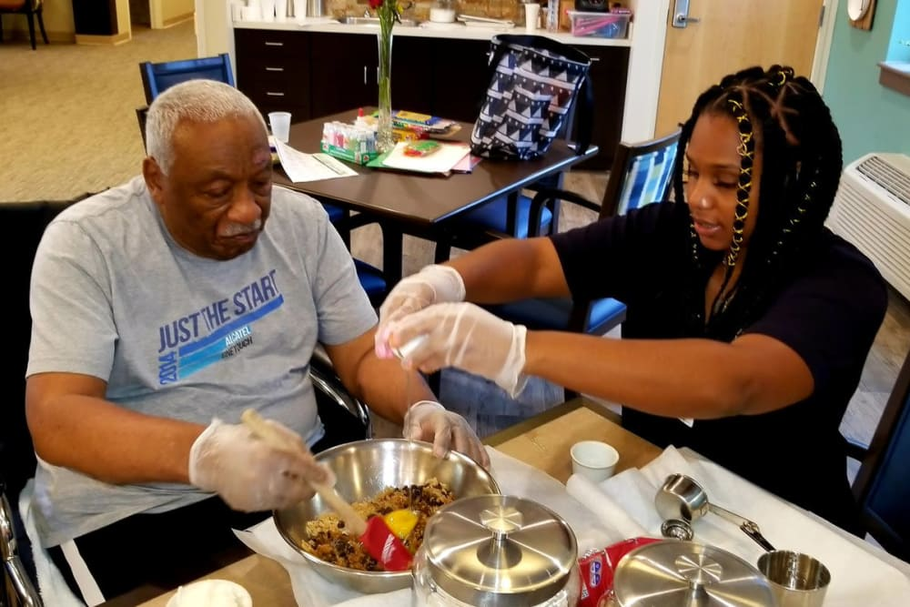 A chef and resident during a cooking lesson at Clearvista Lake Health Campus in Indianapolis, Indiana