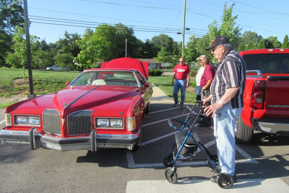 A resident looking at a classic car at Stonecroft Health Campus in Bloomington, Indiana