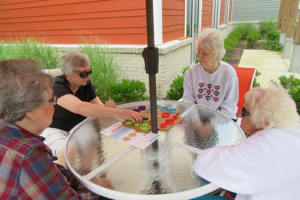A group of residents playing a game outside at Stonecroft Health Campus in Bloomington, Indiana