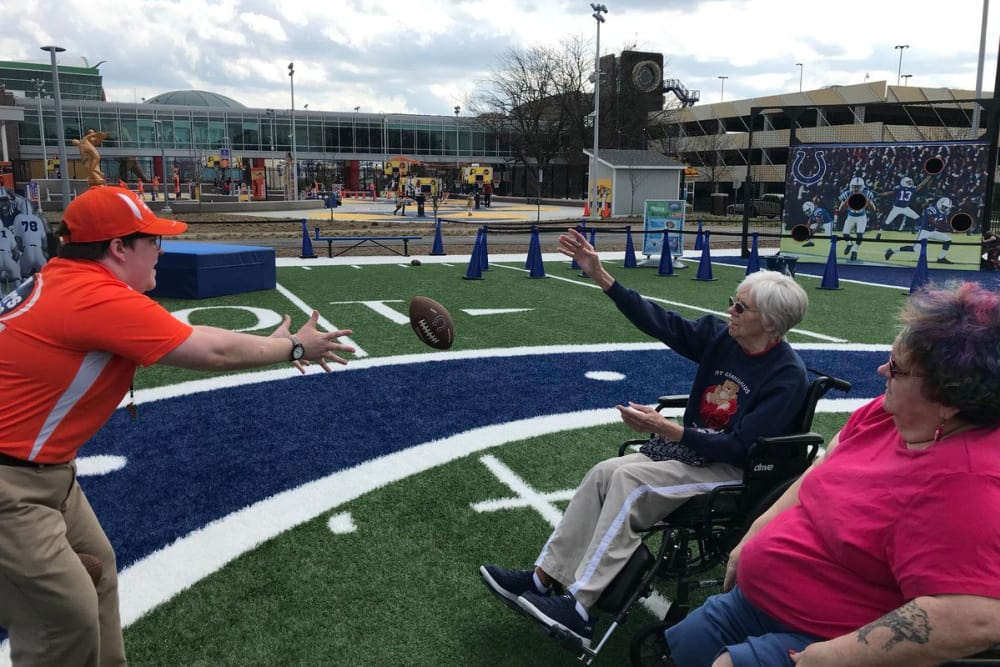 Residents from The Springs of Mooresville in Mooresville, Indiana during a football event